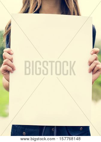 Woman Holding Blank Paper Concept