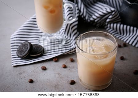 Iced coffee with milk on grey table
