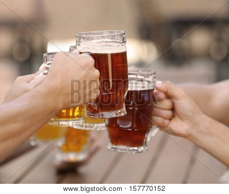 People drinking beer in cafe