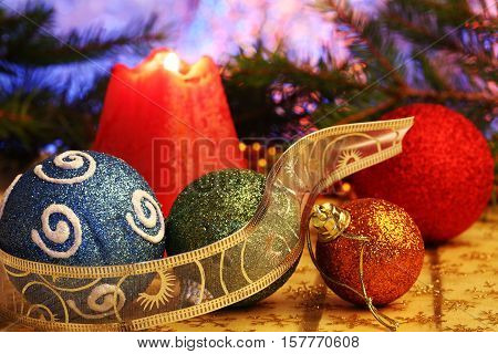 christmas burning candles and balls close up