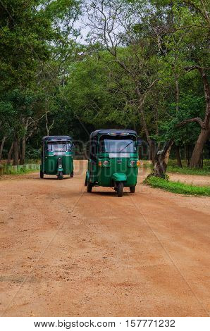 Travelling in Asia.Sri Lanka.Tuk-tuk is transport as taxi.Auto traffic in Ceylon.