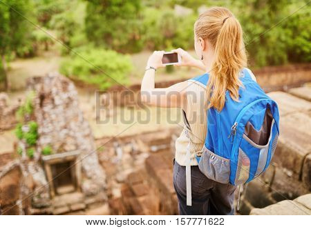 Tourist Taking Picture From Top Of Pre Rup, Angkor, Cambodia
