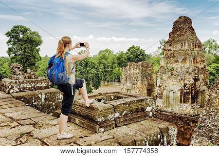 Tourist Taking Picture From Top Of Pre Rup In Angkor, Cambodia