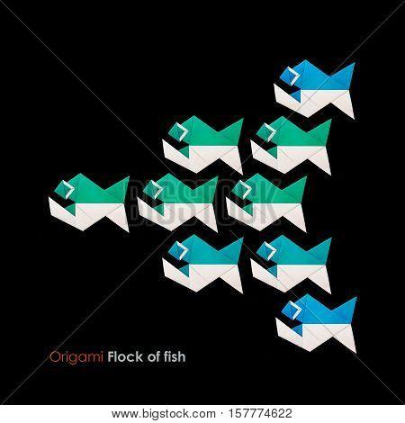 Origami paper piranha school of fish on a black background
