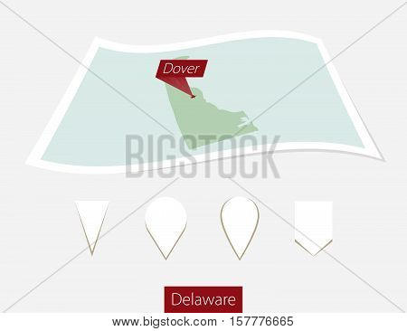 Curved Paper Map Of Delaware State With Capital Dover On Gray Background. Four Different Map Pin Set