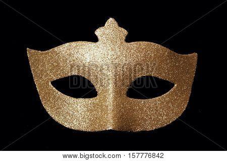 Carnaval golden mask on a black background