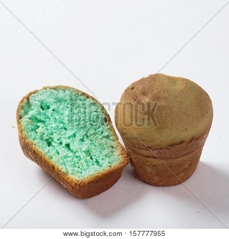 Cake with green stuffing homework on a white background in a cut.