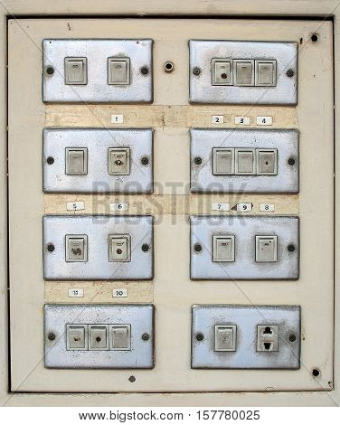Old electrical switch and plug on board. (socket, electric, energy)