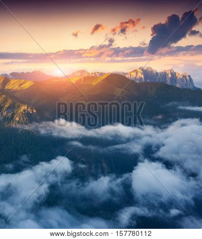 View of the foggy Val di Fassa valley with passo Sella. National Park. Dolomites South Tyrol. Location Canazei Campitello Mazzin. Italy Europe