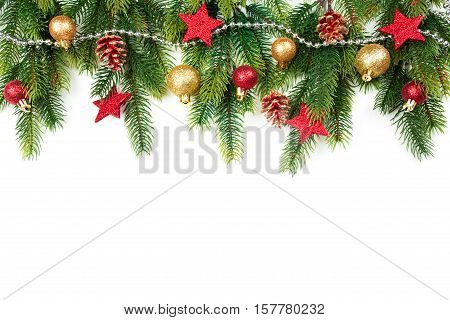 Christmas border with trees, balls, stars and other ornaments, isolated on white. Studio shot