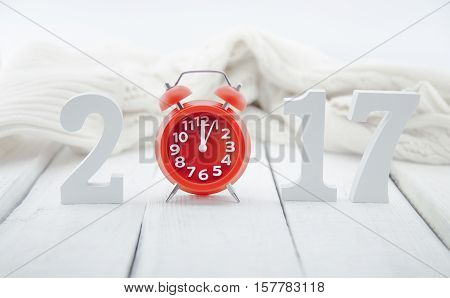 Composition With A Wooden Number 2017 And Red Clock As A Symbol Of The Coming New Year. Happy New Ye