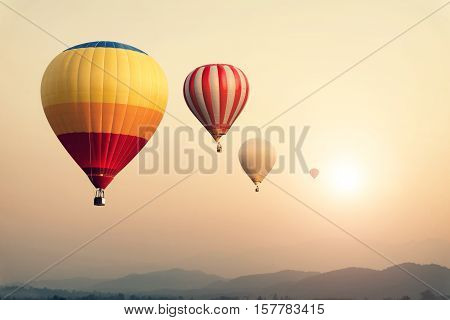 Hot air balloon on sun sky with cloud vintage and retro filter effect style