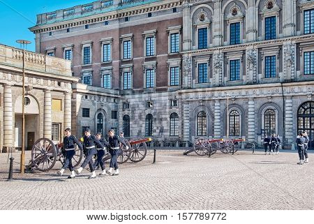 STOCKHOLM, SWEDEN - APRIL 14, 2010: Changing of the Guards at Royal Palace. The Royal Guards has been stationed at the Royal Palace since 1523 and is a popular tourist attraction