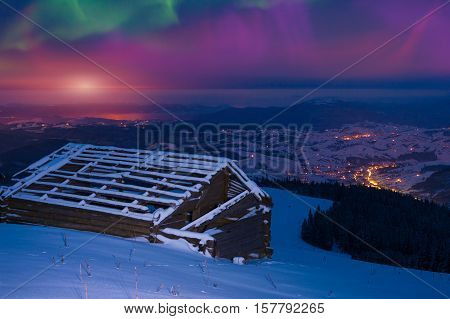 Northern lights in the winter Carpathian mountains