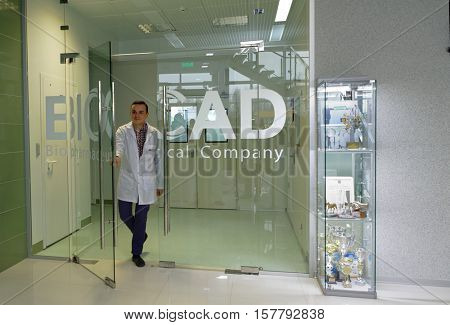 ST. PETERSBURG, RUSSIA - NOVEMBER 16, 2016: Staff go out from the production site of the biotechnology company BIOCAD. It is one of world`s few full-cycle drug development and manufacturing companies