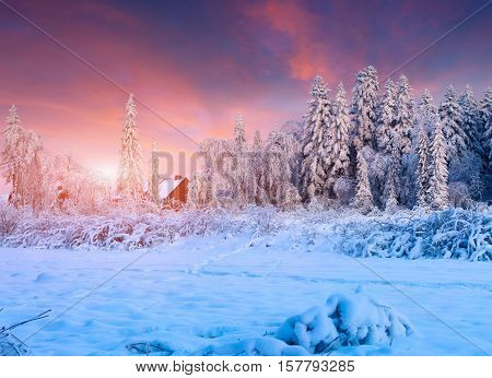 Colorful Winter Sunset In The Mountain Village.