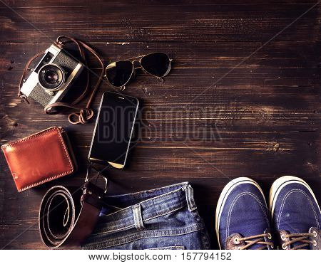 top view (above flat layout) of hipster man fashion accessory on old wooden background - vintage styles