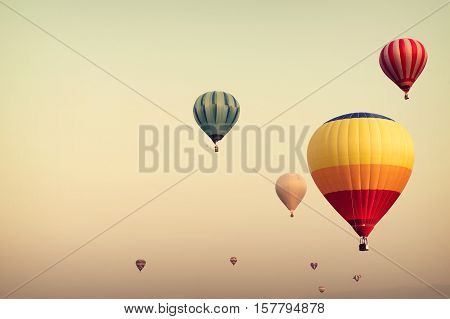 Hot air balloon on sky with fog vintage and retro filter effect style