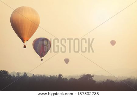 Vintage hot air balloon flying on sky with fog. photo vintage of travel and air transportation -vintage with retro filter effect style