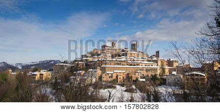 Panoramic view of Sarnano covered by snow, Marche - Italy