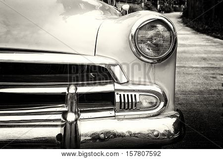 headlight lamp vintage classic car parked black and white vintage film grain filter effect styles