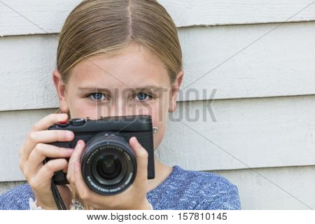 Girl child taking picture with a camera