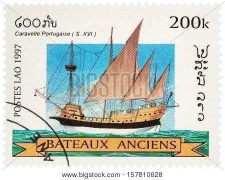 MOSCOW RUSSIA - NOVEMBER 18 2016: A stamp printed in Laos shows ancient Portuguese caravel (16th-century) series
