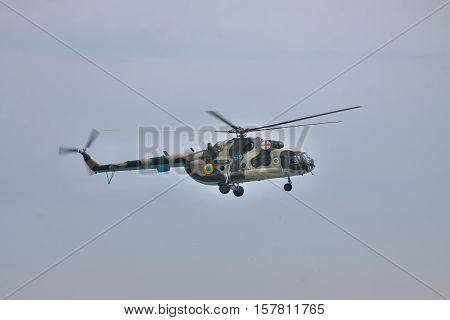 Vasilkov Ukraine - April 24 2012: Ukrainian Air Force Mi-8 medevac helicopter is landing in clear sky