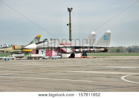 Vasilkov Ukraine - April 24 2012: Ukraine Air Force MiG-29 on the airfield with its weapons near it and Aero L-39 Albatros is parked behind the MiG