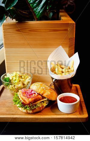 A Tray Of Fast Food: Fish Burger With Salad And Fries