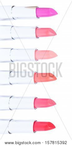 Border of puple, pink and red shades of open lipsticks isolated on white background