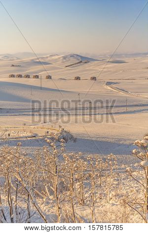 RURAL LANDSCAPE WINTER. Between Apulia and Basilicata. snowy hills landscape with farmhouses. ITALY.