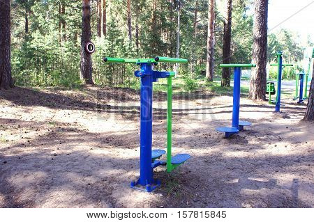 Exercise equipment in the Park. Fitness equipment. Exercise equipment for legs at conifer Park.