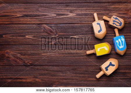 Dreidels for Hanukkah on wooden table