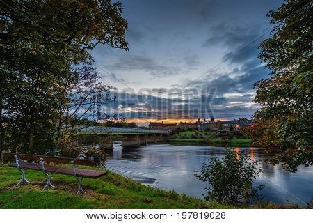 Wark Bridge over North Tyne in twilight, as the river passes the village of Wark in Northumberland on its way to the confluence with the South Tyne