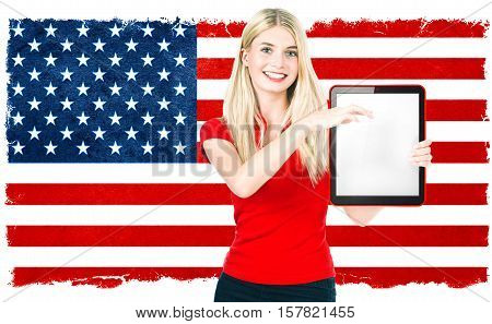 Young woman with american national flag on the background holding tablet pc. US Election results