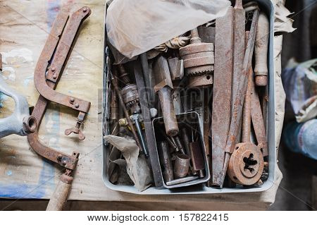 still life tool box with nails rasp and old tools.