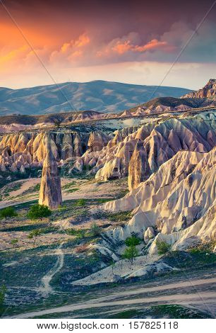 Unreal World Of Cappadocia. Sunrise In Red Rose Valley In April. Chavushin Village Located, District