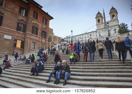 ROME ITALY - NOVEMBER 8 : large number of tourist sitting on spanish step important traveling landmark and shopping point on november 8 2016 in rome italy