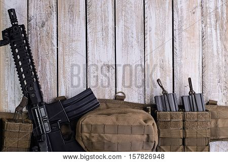 Assault US riflearmy belt with ammo on wooden table.Top view