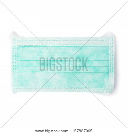 Green medical surgical flu illness protective mask over isolated white background