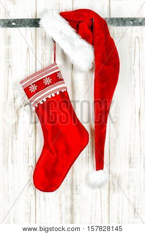Festive Christmas decoration with red ornaments. Christmas stocking