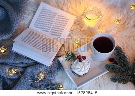 Cup of hot tea on winter background