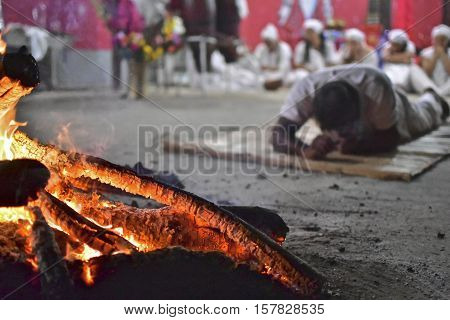 Ceremony of religion Umbanda, faithful next campfire in praying to Orixá Xango. Rio de Janeiro. July 1, 2016