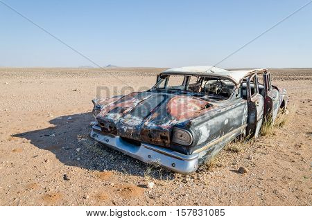 Wreck of classic saloon car abandoned deep in the Namib Desert of Angola. What caused the accident and what happened to the travelers remains a mystery.