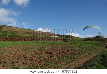 ROCCA PRIORA ITALY - NOVEMBER 1 2016: paragliding lesson paraglider landing after a training flight