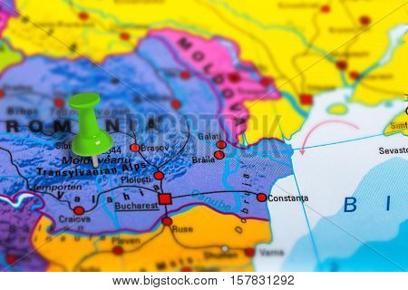 Transylvania in Romania pinned on colorful political map of Europe. Geopolitical school atlas. Tilt shift effect.