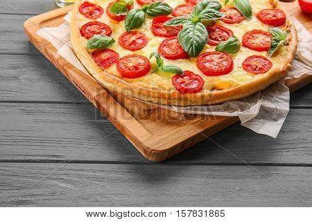 Fresh tasty pizza Margarita on wooden tray