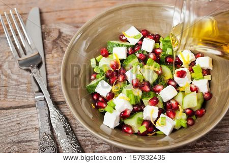 Fresh  Green Salad With Pomegranate Seeds, Cucumber And Feta Cheese