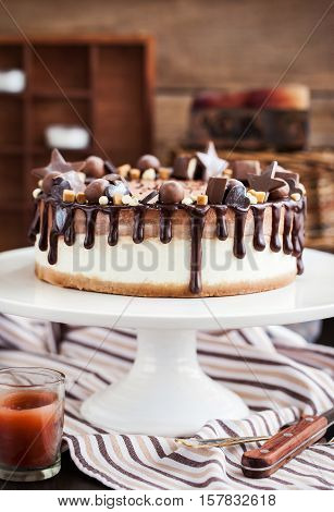 Two-ply Chocolate Cheesecake Decorated With Candies And Frosting